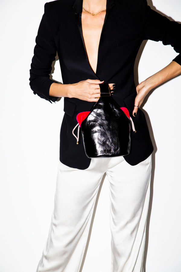 Kit Bracelet Bag in Black Leather with Fuchsia Pouch