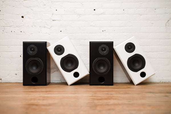 Wrensilva Monitor speakers in white and walnut or black and walnut.  Removable screens and optional steel speaker stands.