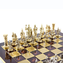 GREEK ROMAN PERIOD CHESS SET with gold/silver chessmen and bronze chessboard red