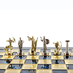 GIANTS' BATTLE CHESS SET with gold/silver chessmen and bronze chessboard blue