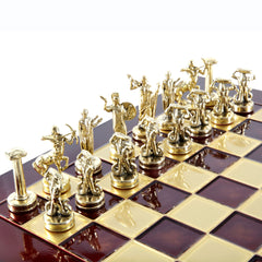 GIANTS' BATTLE CHESS SET with gold/silver chessmen and bronze chessboard red