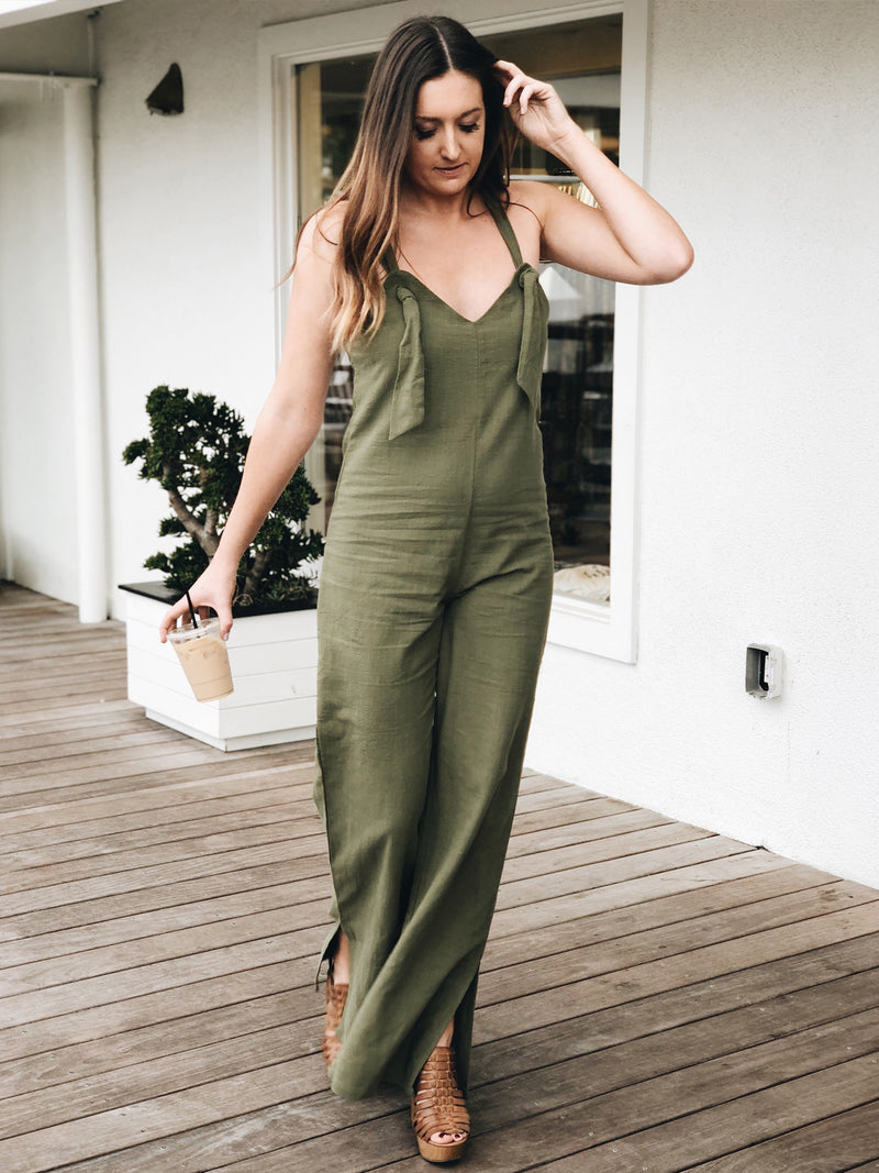 These overalls feature tied knot straps and a slitted wide-leg silhouette.