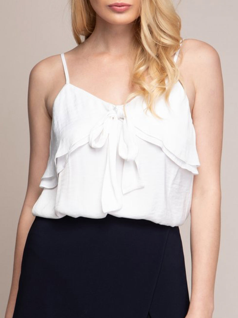 This white cami features an extra flowy layer on top that wraps around that ties in front (plus, adjustable straps).