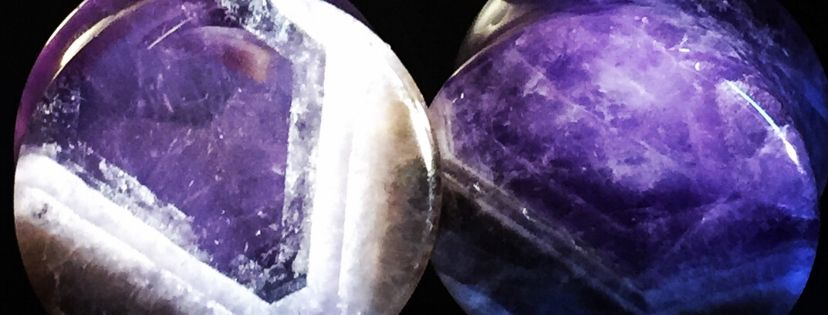 a pair of amethyst stone plugs