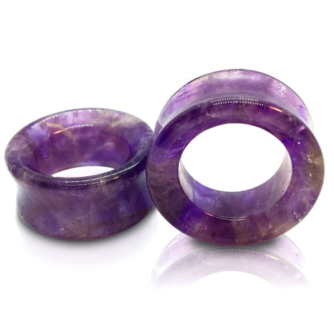 A pair of amethyst stone tunnels for stretched ears