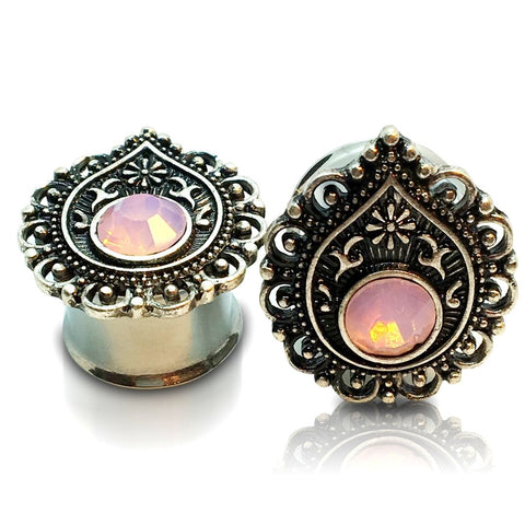 A pair of steel teardrop plugs with pink opalite inlay