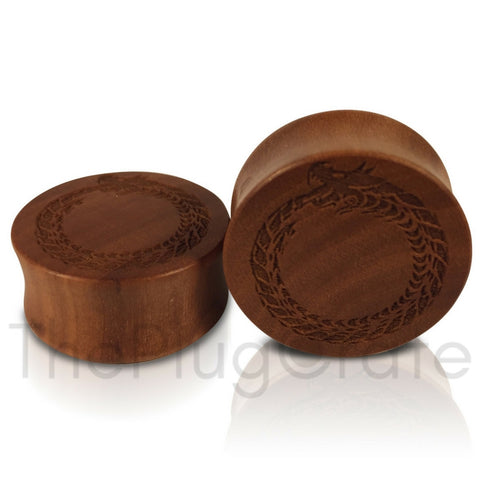 A pair of Engraved Celtic Serpent Plugs for stretched ears