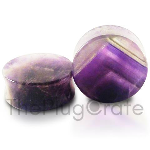 A pair of organic purple amethyst stone plugs for stretched ears;