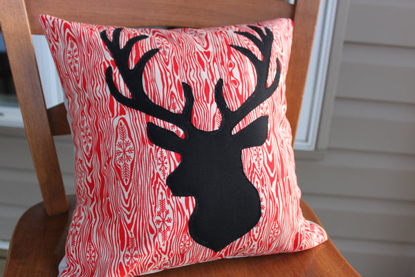 Deer Pillow on Red Wood Grain with Grey envelope back Winter Seasonal Pillow