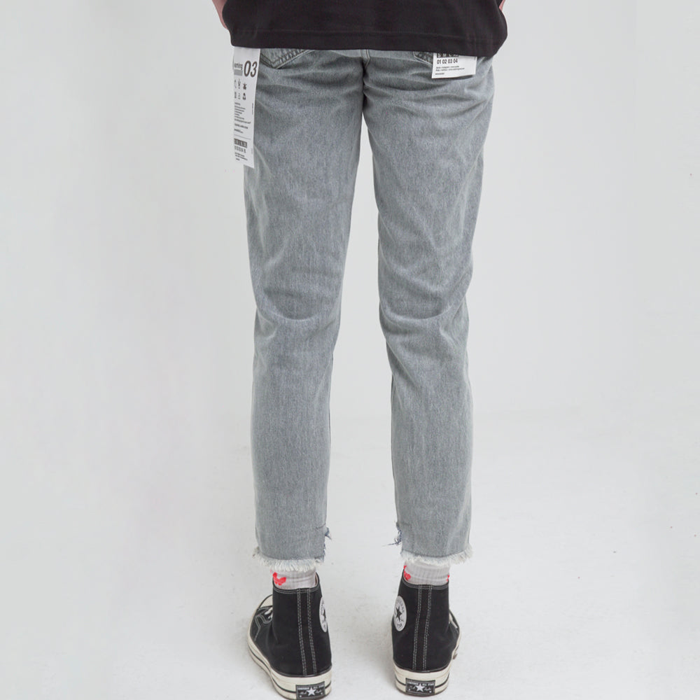 Washed Denim with Uneven Detailing