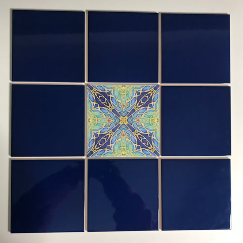 Patterned tile inserted into plain coloured tiles of different sizes