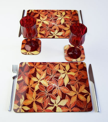 Table Top, Beech Leaves in red yellow chocolate, available in place mats, coasters, glass chopping boards / counter savers, serving trays, mugs and mouse mats