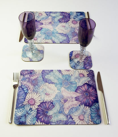 Table Top, Butterflies and Flowers,  in pale blue, lilac and pale turquoise, available in place mats, coasters, glass chopping boards / counter savers, serving trays, mugs and mouse mats