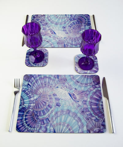 Table Top, Clam Shells, in pale blue, lilac and pale turquoise, available in place mats, coasters, glass chopping boards / counter savers, serving trays, mugs and mouse mats
