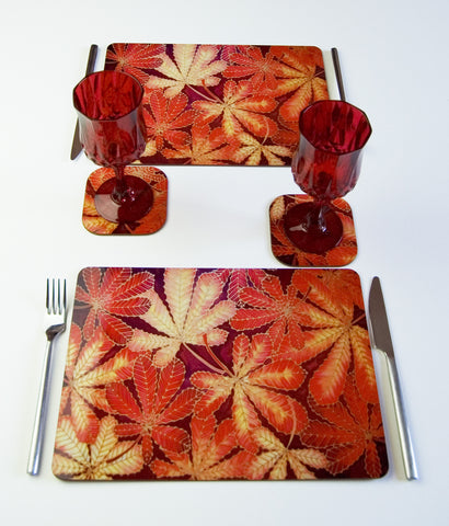 Tableware, Horse Chestnut Leaves design, in red yellow chocolate, available in place mats, coasters, glass chopping boards / counter savers, serving trays, mugs and mouse mats