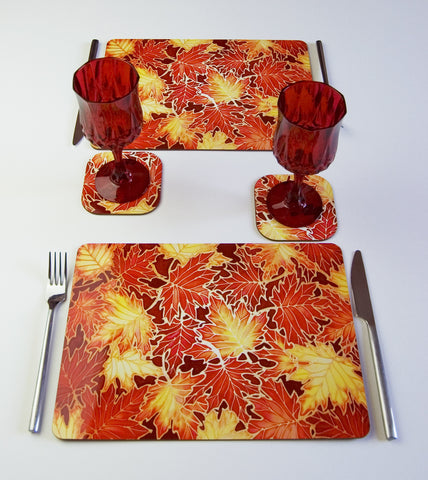 Table Top, Maple Leaves design, in red yellow colours, available in place mats, coasters, glass chopping boards / counter savers, serving trays, mugs and mouse mats
