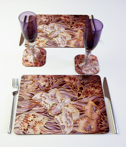 Tableware, Moths on Bark design, in Chocolate, Lilac and grey colours, available in place mats, coasters, glass chopping boards / counter savers, serving trays, mugs and mouse mats