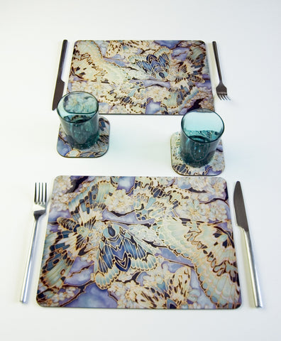 Tableware, Moths on Lichen design, in sage green, teal and grey colours, available in place mats, coasters, glass chopping boards / counter savers, serving trays, mugs and mouse mats