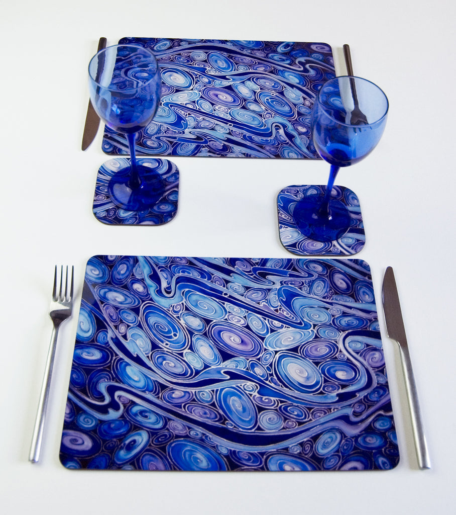 Table Top, Pebbles design, in  blue, navy and prussian blue colours, available in place mats, coasters, glass chopping boards / counter savers, serving trays, mugs and mouse mats