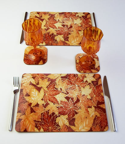 Tableware, Virginia Creeper Leaves design, in caramel and chocolate colours, available in place mats, coasters, glass chopping boards / counter savers, serving trays, mugs and mouse mats