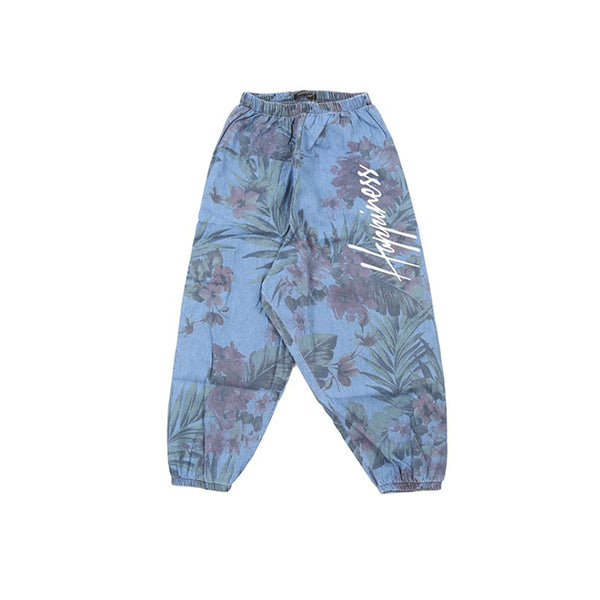 "woven floral baggy pants with ""Happiness"" printed on the leg"