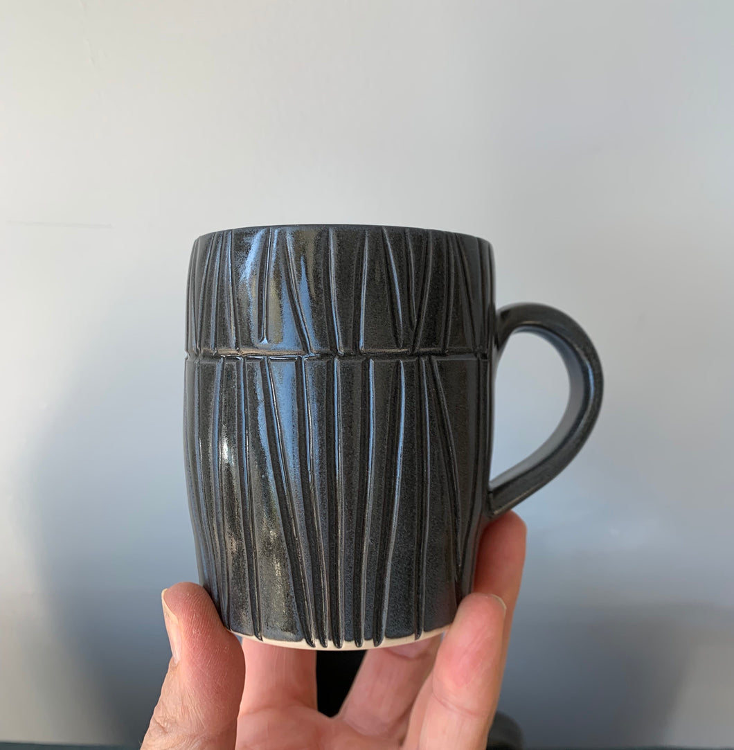 Vertical lined dark pot