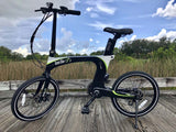 Green Bike USA Carbon Lightweight Electric Bike black green outdoors