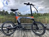 Green Bike USA Carbon Lightweight Electric Bike black orange outdoors right