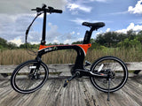 Green Bike USA Carbon Lightweight Electric Bike black orange outdoors