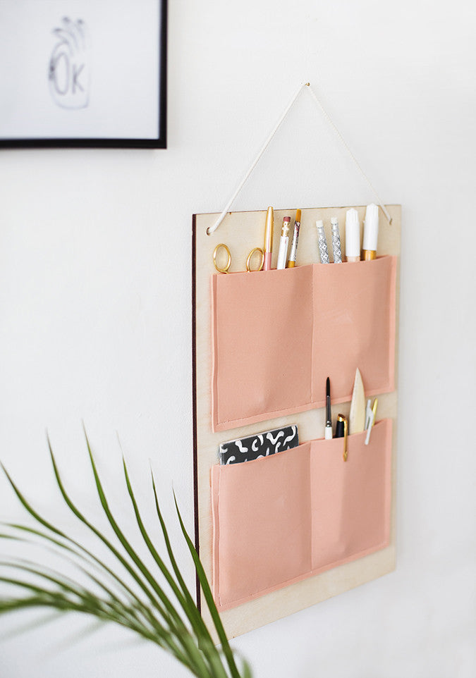DIY Hanging Organizer by The Lovely Drawer