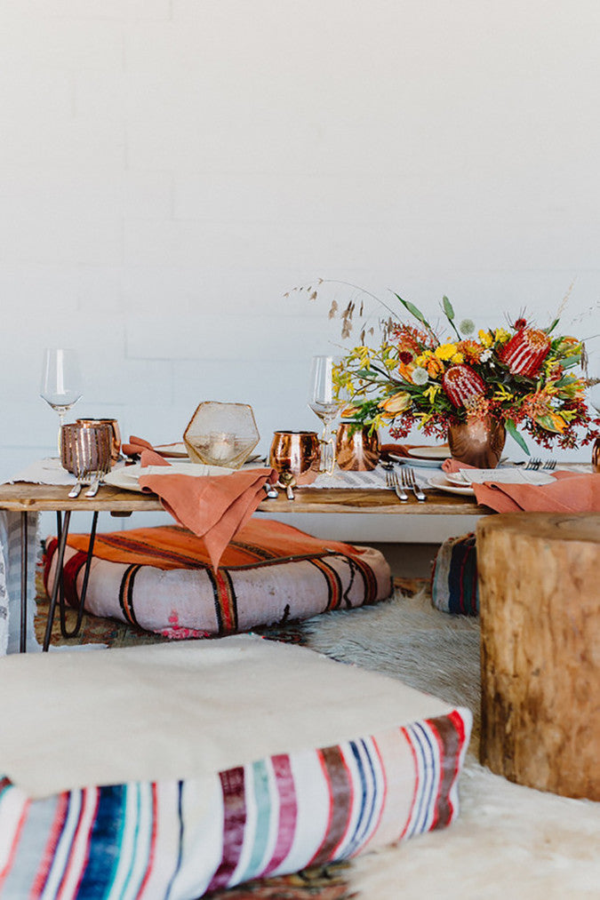 Floor Seating Outdoor Party - Image via 100 Layer Cake