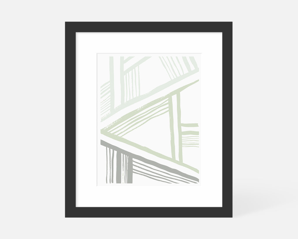 sage green abstract art print in black frame