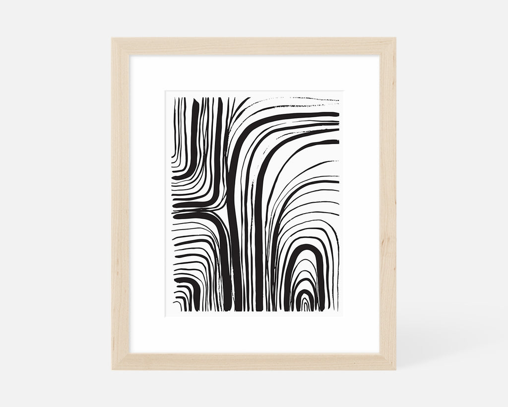 black and white abstract art print with natural wood frame