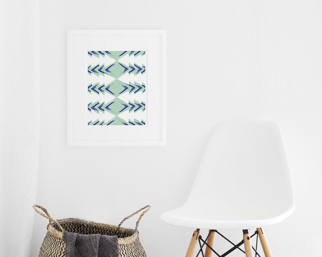 framed blue and green mid century modern art print on display