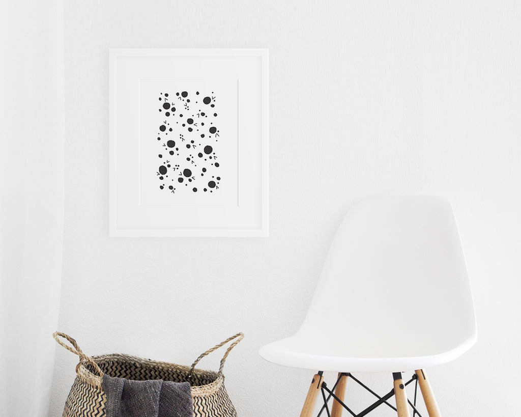 framed black and white Scandinavian art print on display