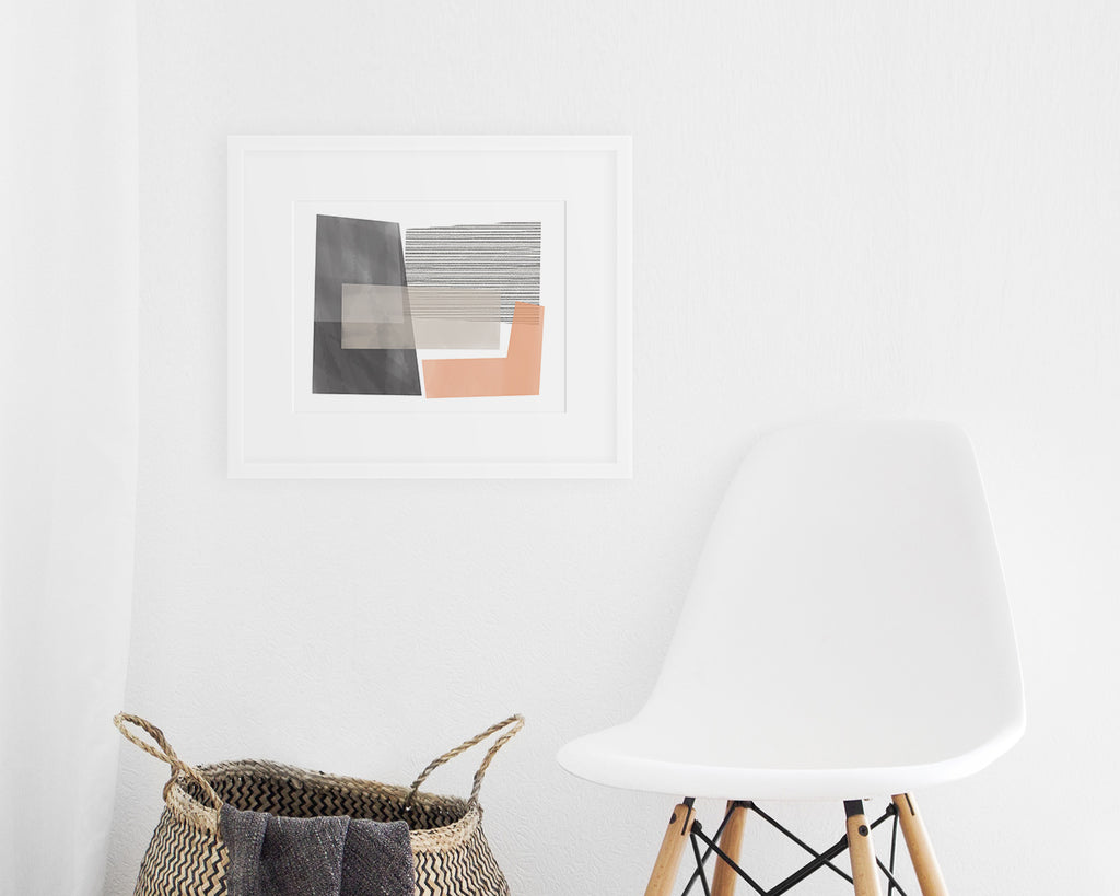 framed pink and gray Mid Century Modern art print on display