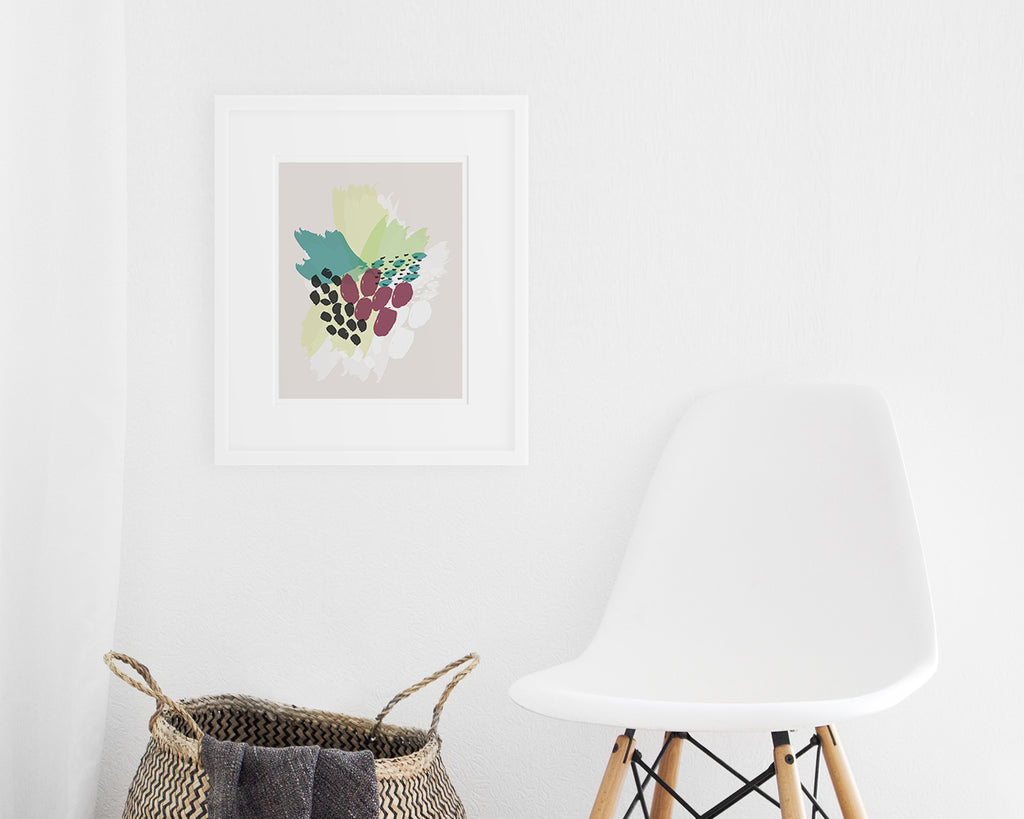 framed purple and green abstract floral art print on display