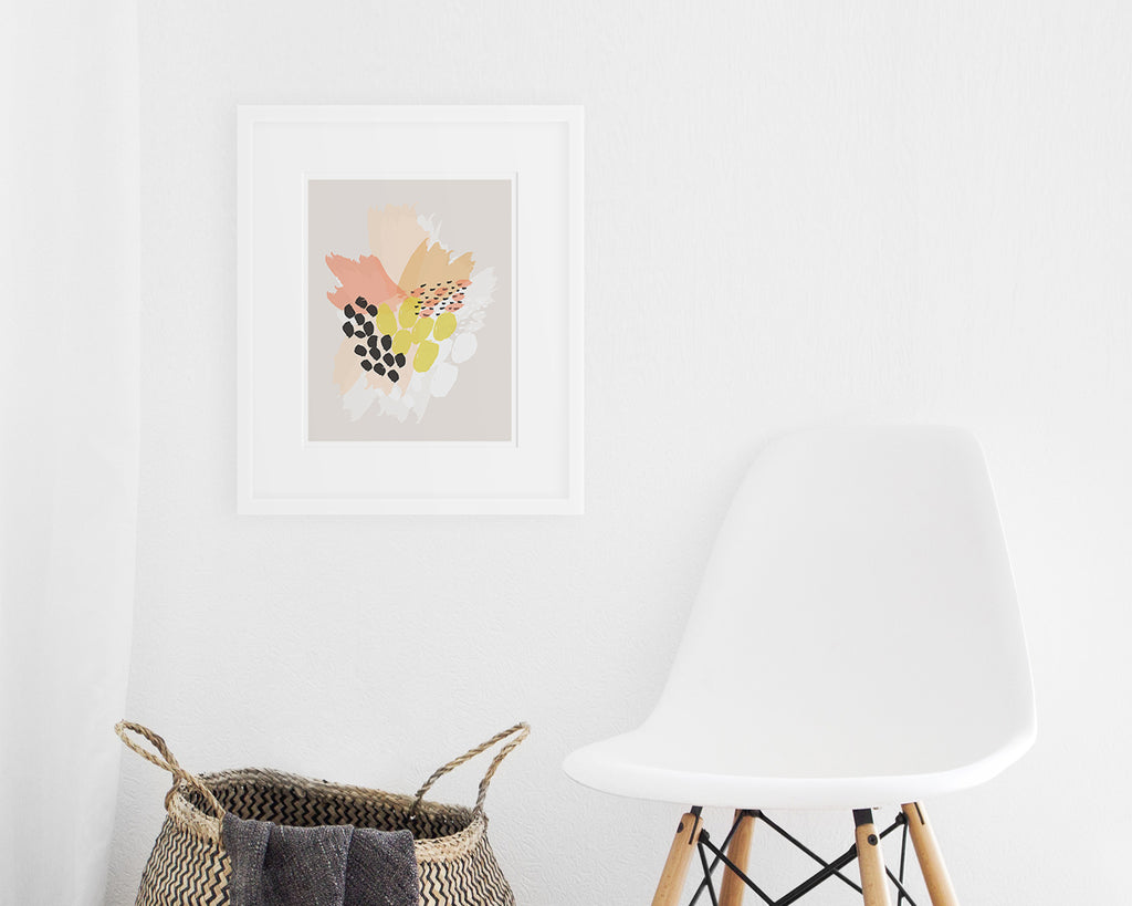 framed pink orange and yellow abstract floral art print on display