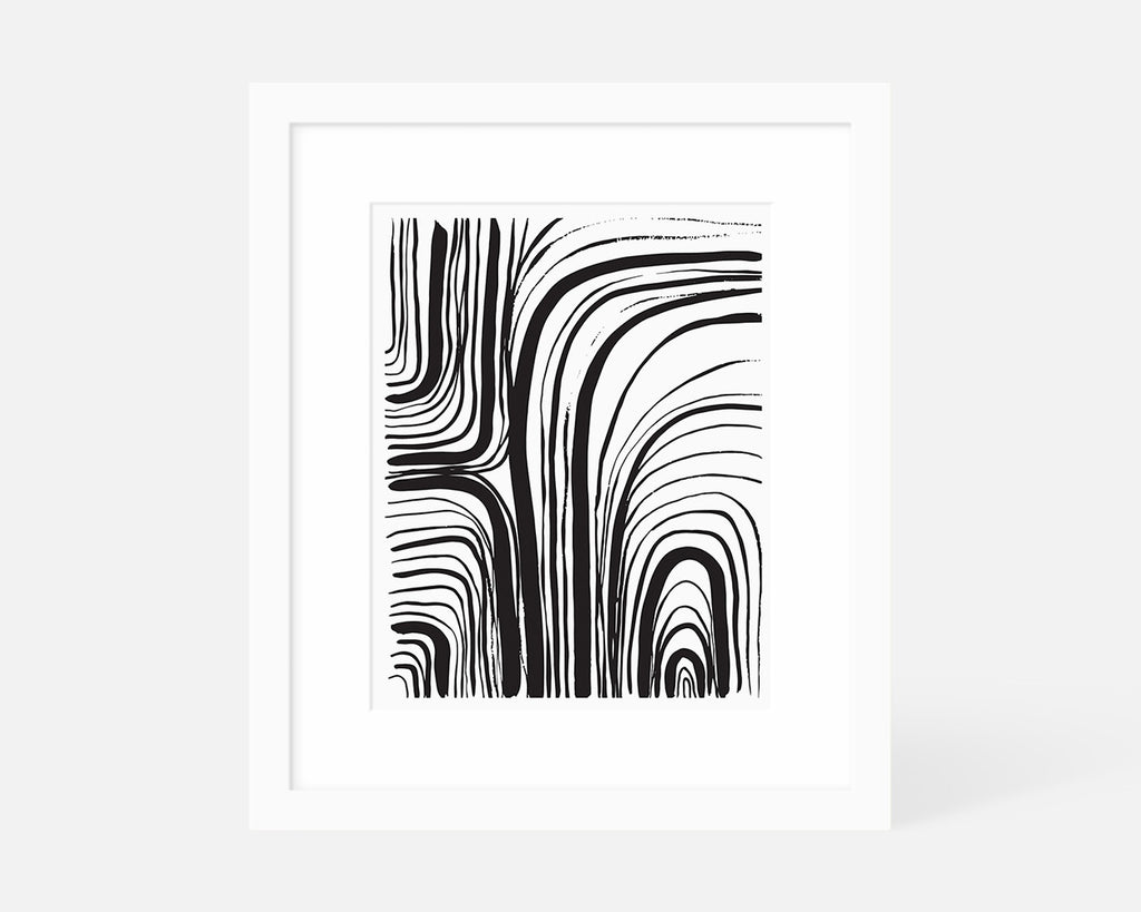 black and white abstract art print with white frame