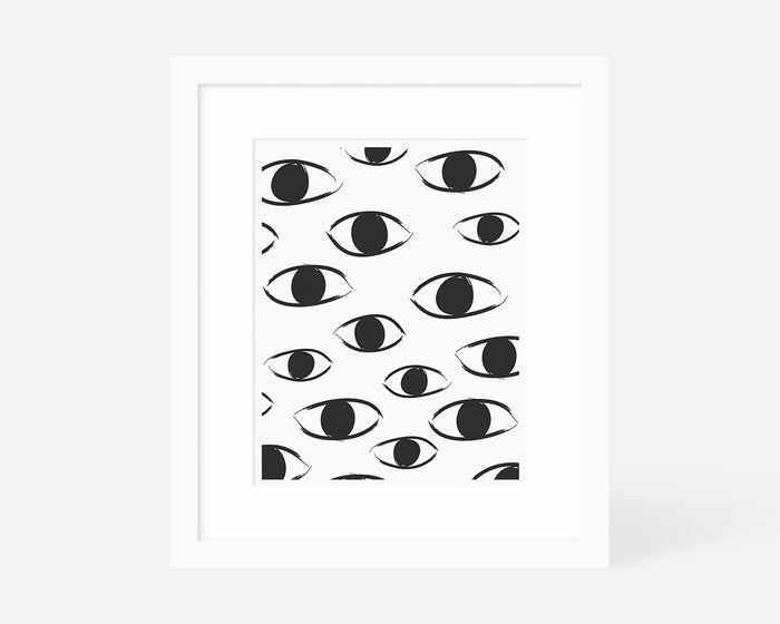 black and white abstract eye art print with white frame