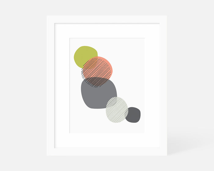 graphic art print with overlapping circles in pink green and gray with white frame