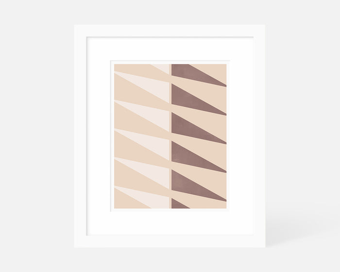 pink geometric triangle art print with white frame