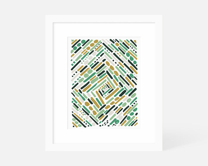 green and yellow abstract art print with white frame