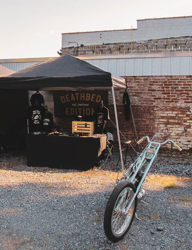 Deathbed Edition setup at the Keystone Collective show Lancaster PA Prism Supply Co Harley Davidson chopper in front