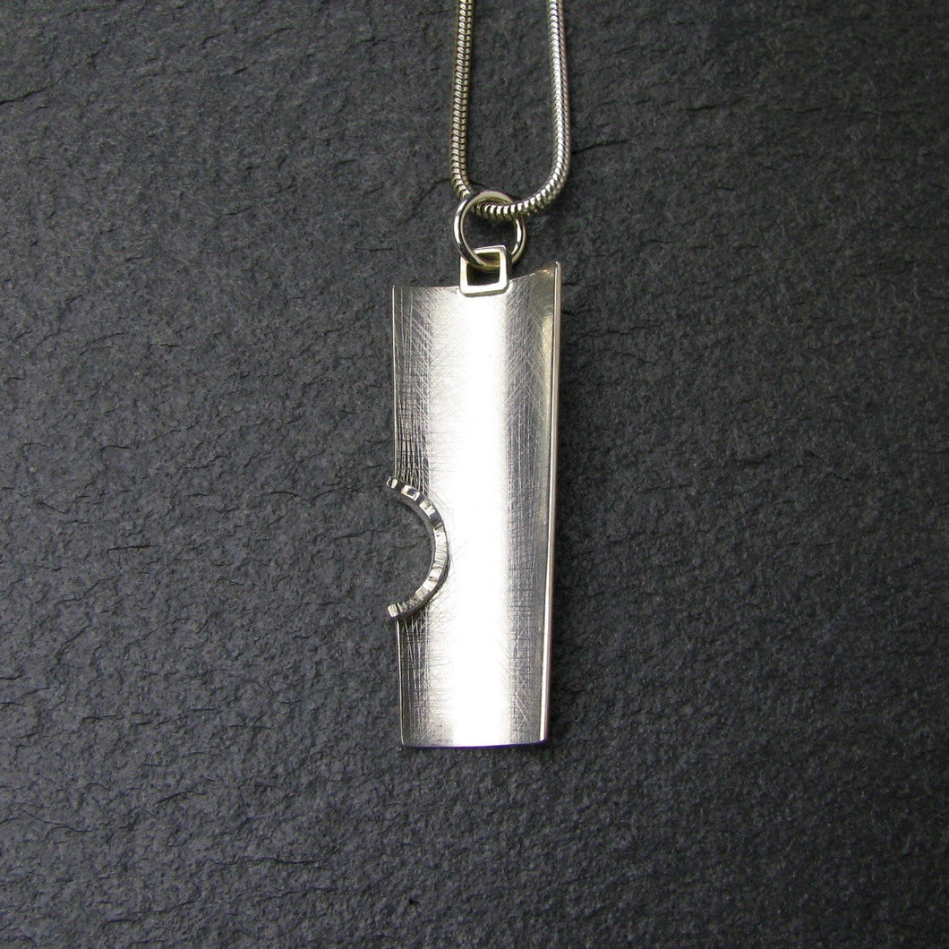 Curve modern pendant in sterling silver.