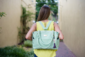 Frankie Lou Ivonne leather diaper bag worn as a backpack in pistachio
