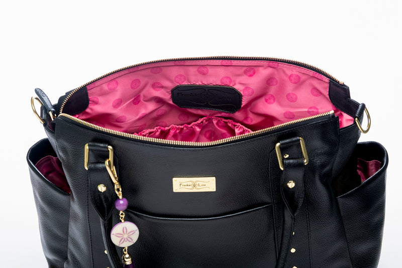 the pink lining of the Frankie Lou Ivonne leather diaper bag