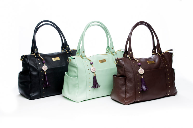 The Frankie Lou leather convertible diaper bag in black, pistachio, and brown