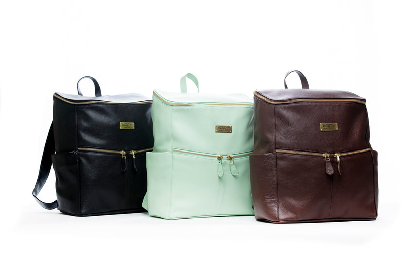 The Frankie Lou Maria leather diaper bag backpack in black, pistachio, and brown
