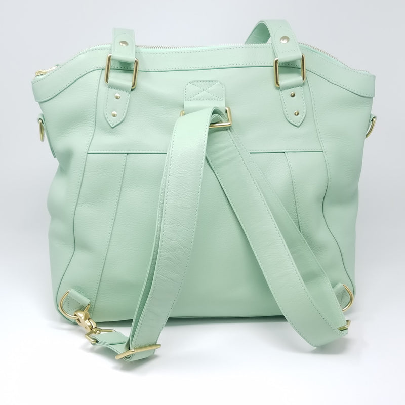 Frankie Lou IJoann convertible leather diaper bag in pistachio showing backpack strap